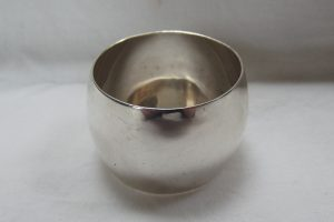 Wide picture of silver barrel shaped napkin ring