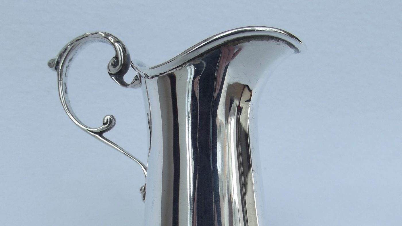 Closeup shot of plain silver cream jug