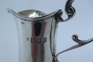 Hallmark on silver cream jug