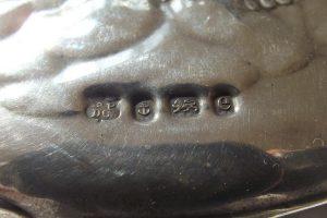 Closeup of hallmarks on silver hand mirror