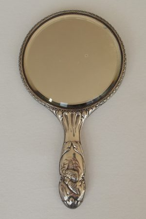 Face of silver hand mirror