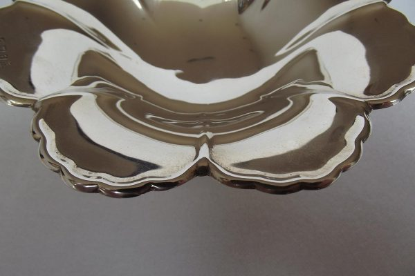 Closeup of detail on silver petal dish