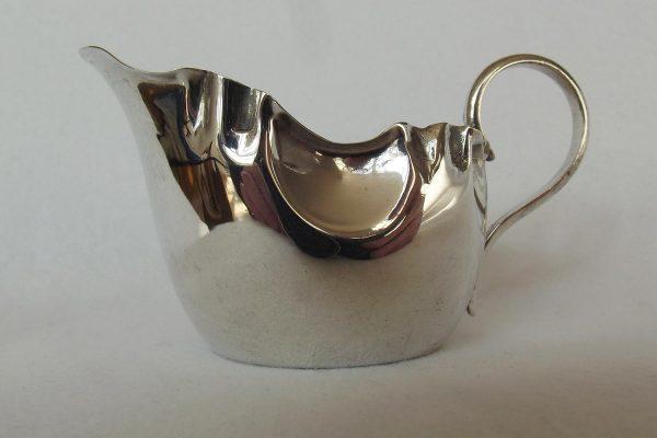 Small silver cream jug