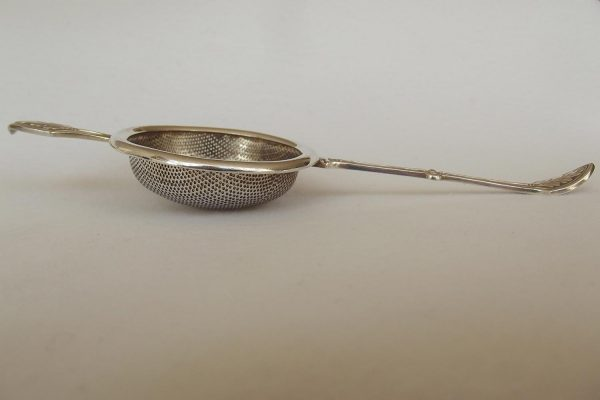 Profile shot of silver plated tea strainer