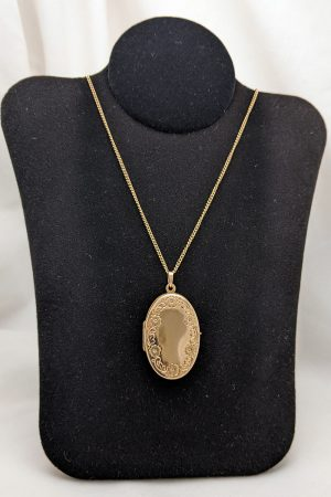 Gold oval locket necklace